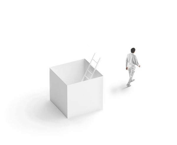 A man walking away from the box