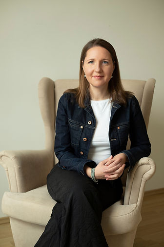 Julia Lyubchenko sitting on the chair in her office