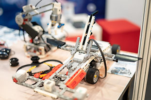 robots-made-from-lego-on-a-table-at-an-e