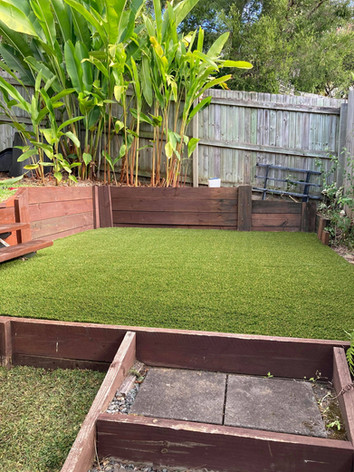 Synthetic with a bottom layer of natural turf