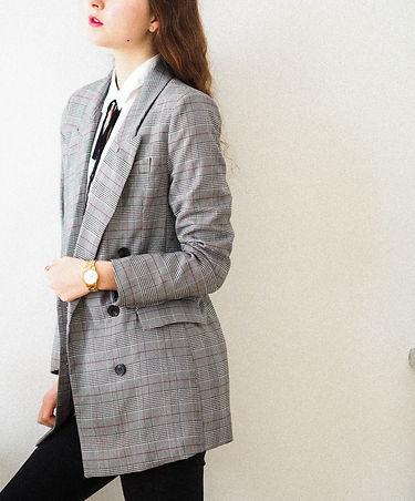 woman in gray coat standing_edited.jpg