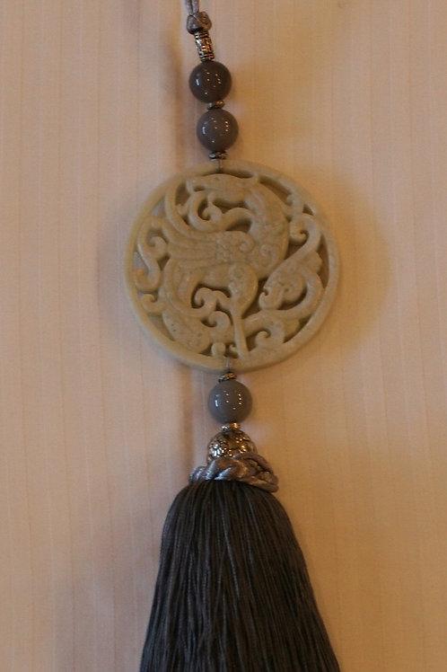 Carved sand medallion with grey tassel