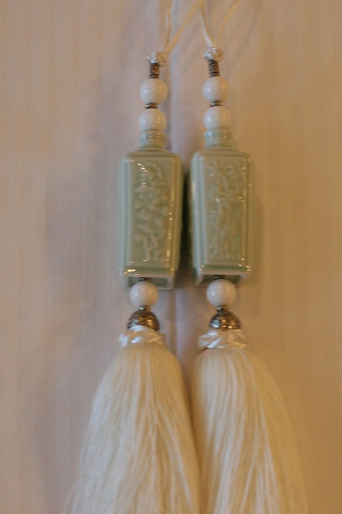 pair of celadon jars with cream tassel
