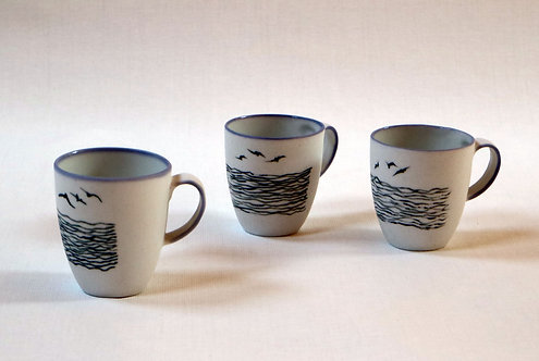 White porcelain cups, decorated black. Sold per pair.