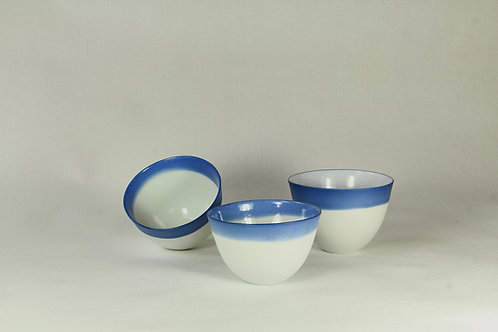 White and blue porcelain cups. Sold per pair.