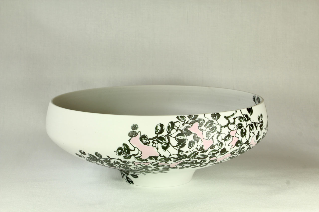 Black decoration on white porcelain bowl