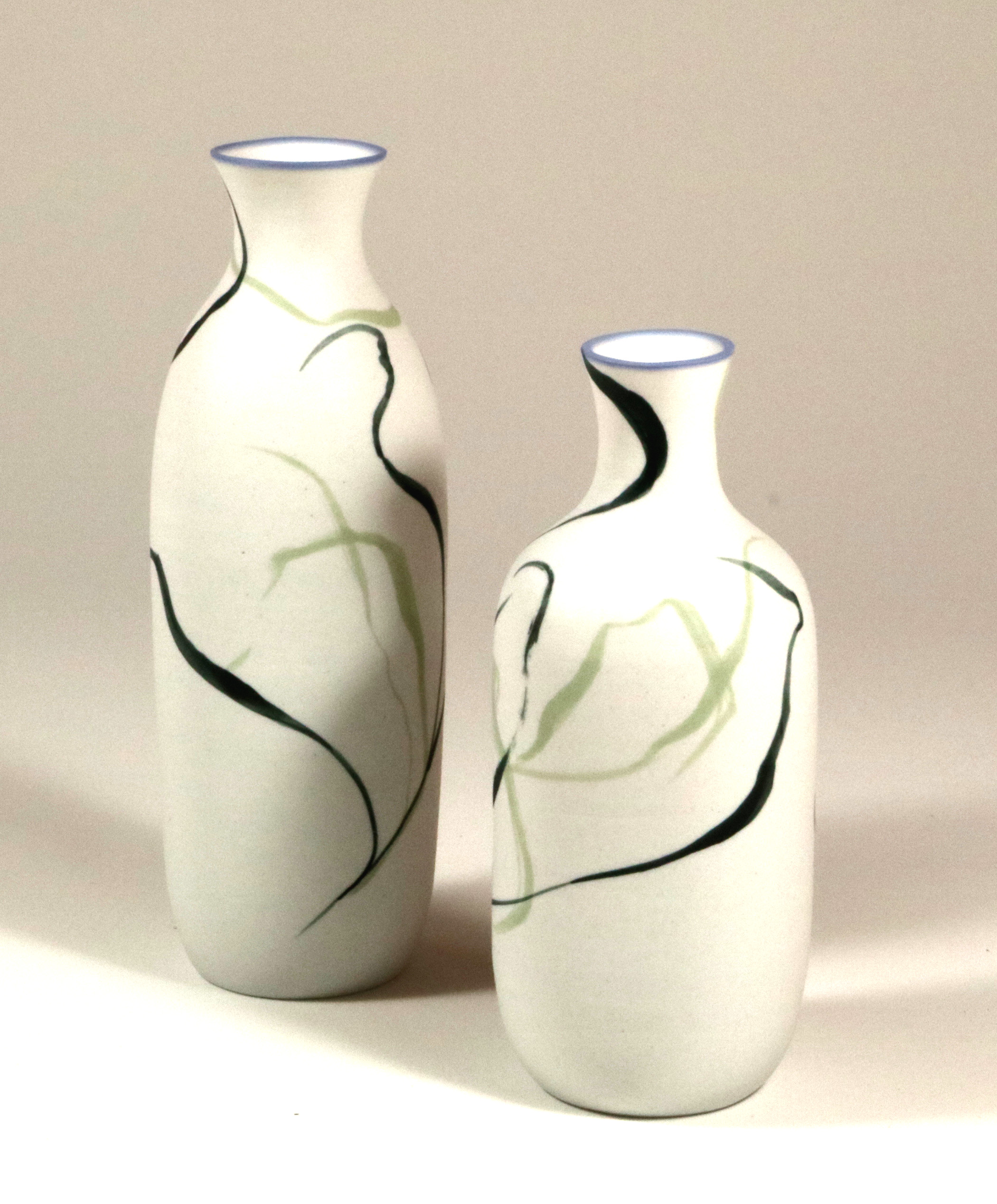 Porcelain bottles, black slip and green