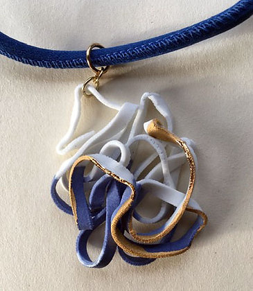 Porcelain pendant on dark  blue silk necklace.