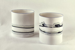 black on white porcelain containers