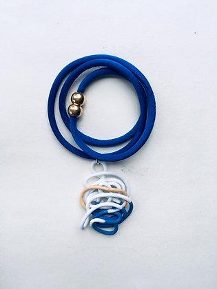 Porcelain pendant on blue silk necklace