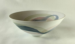colored swirls on white porcelain bowl