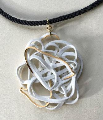 Porcelain pendant on black silk necklace.