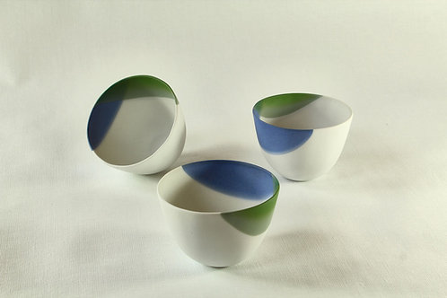 White porcelain cups, decorated blue and green. Sold per pair.
