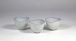 porcelain cups. Blue rim. Glazed inside.