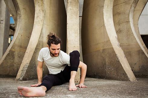 man practicing yoga pose