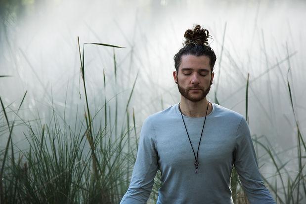 man meditating yoga