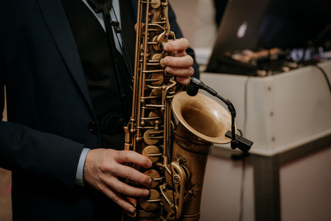 Charlotte Deckers Photography | Event Photographer | Close Up Saxophone player hands Music