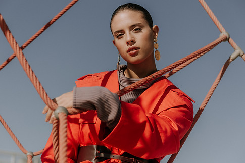 Charlotte Deckers Photography | Fashion Editorial Photoshoot Exterior Female Model with red jacket