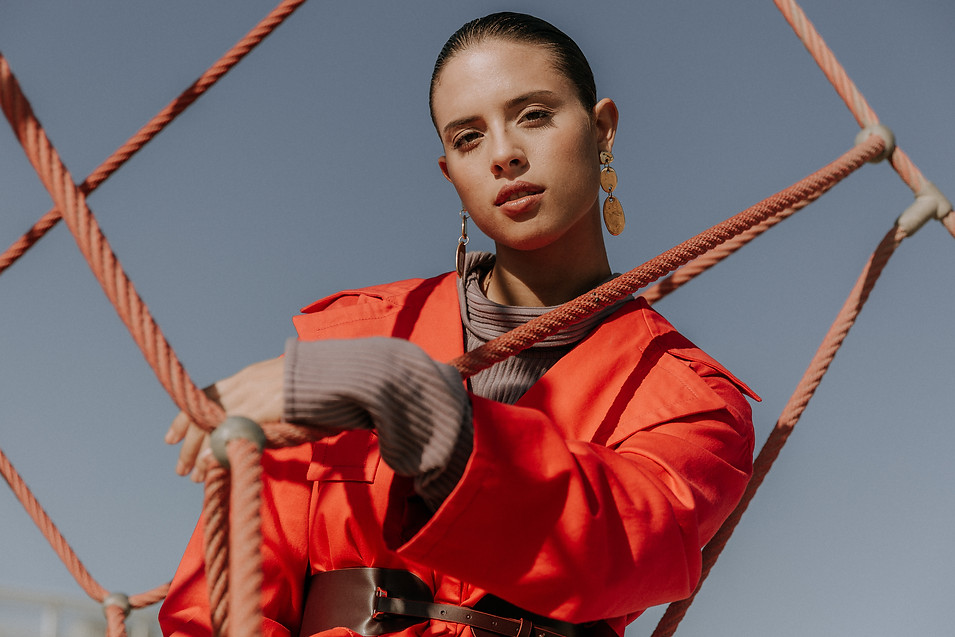 Charlotte Deckers Photography   Fashion Editorial Photoshoot Exterior Female Model with red jacket