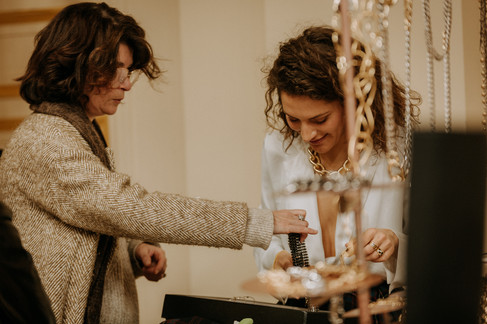 Charlotte Deckers Photography | Event Photographer | Women at showroom jewelry stand