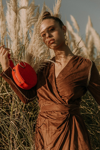 Charlotte Deckers Photography | Fashion Editorial Photoshoot Exterior Female Model with red bag