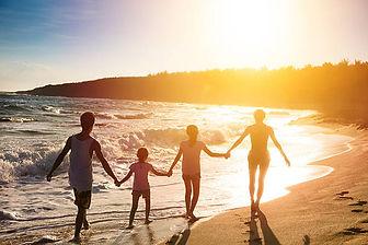 family walking on beach.jpg