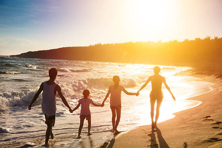 family walking on beach.jpg