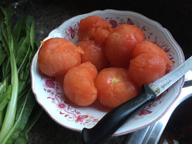 Peeled tomatoes ready to cook
