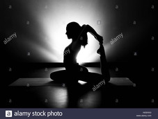 woman-doing-yoga-pigeon-pose-silhouette-