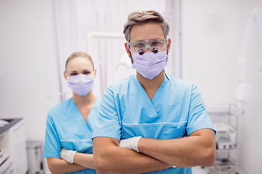 dentist-standing-with-arms-crossed-denta