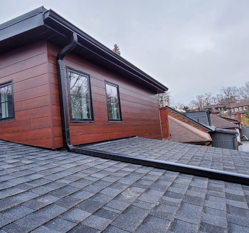 Longboard Siding with Black Downspout and Gutters