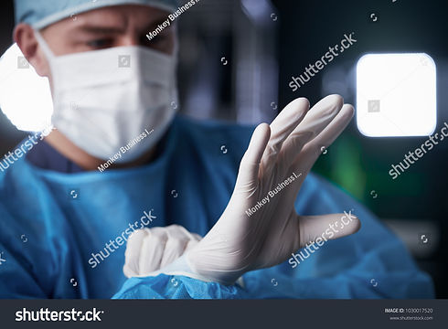 stock-photo-male-surgeon-putting-on-late