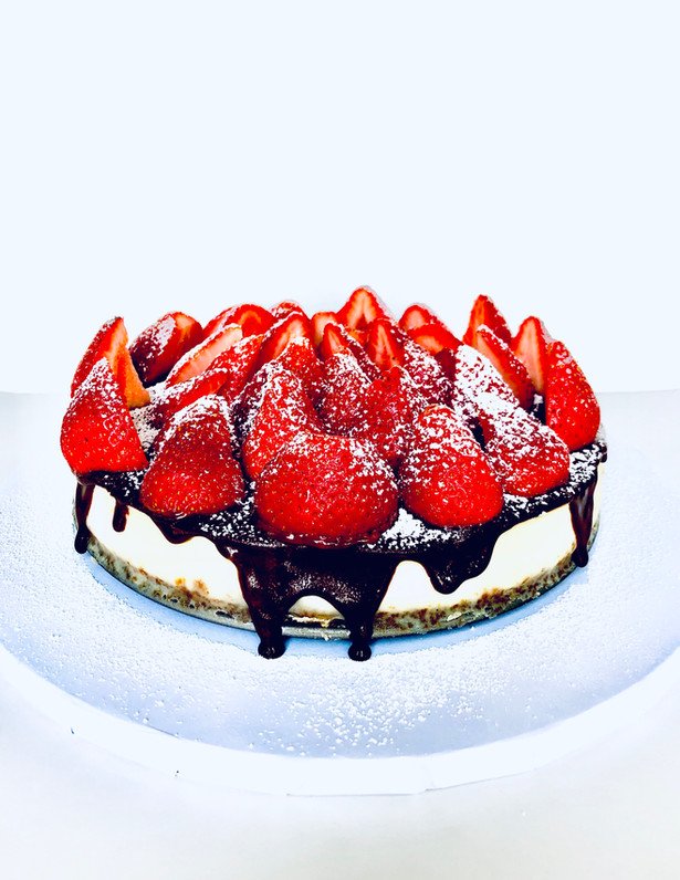 Cheesecake with Chocolate Drizzle and Strawberries