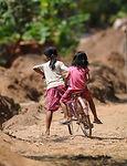 2girls-bikes-cambodia.jpg