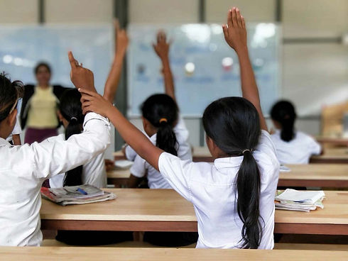 kids-hands-up-classroom.jpg