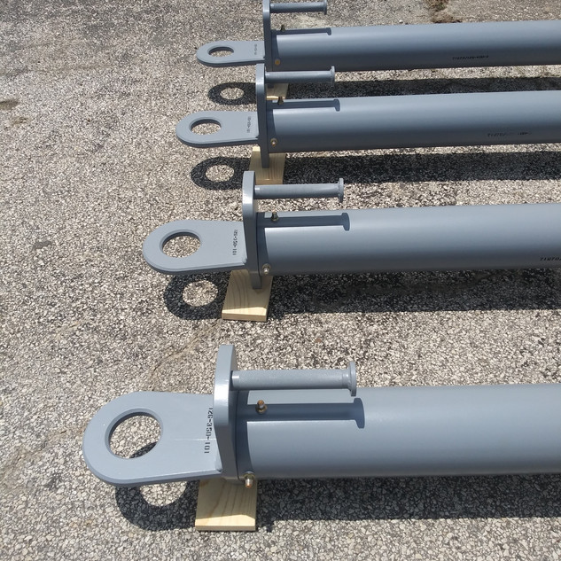 """Part Number: 126-000-101  Description The unit consists of an aluminum round tube, tow vehicle hook and aircraft latch/hook with solid polyurethane wheels. This unit is equal to LMC part number 403980-1 and the Manson 130-2.  Function Used to tow the C-130 aircraft  Dimensions & Weight 183"""" (L) X 15"""" (W) X 11"""" (T) X 175 lbs."""