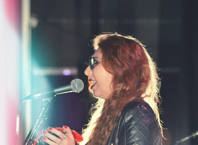 April Rose singing backing vocals