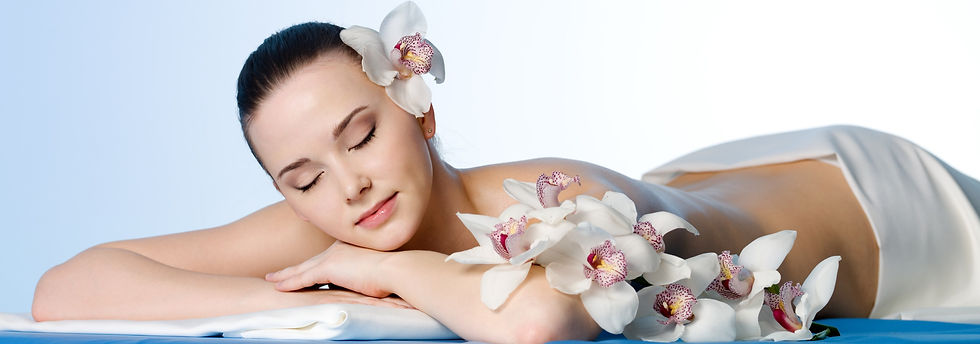 woman-resting-beauty-spa-salon-with-flowers-colored-space_edited.jpg