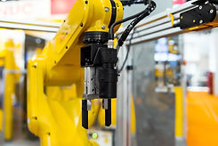 Robot-arm-in-a-factory-450142203_1254x83