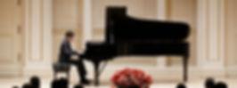 Performing at Carnegie Hall.._