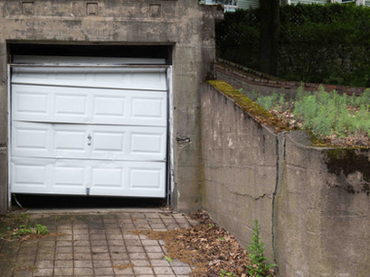 Backed into your garage door? Let us straighten you out!