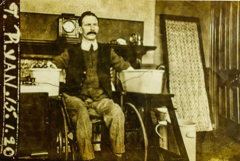 Photograph of Thomas Ryan having electrotherapy 1879-1945