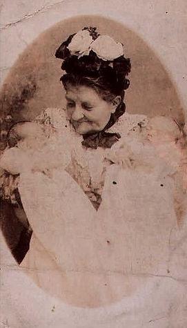 Newborn twins with grandmother 1870's