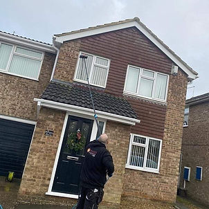 Residential windows being cleaned profes