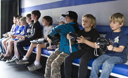 1024px-Children_playing_video_games