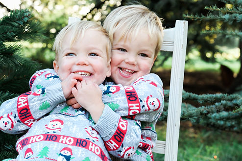Twin boys during a Christmas Mini Session at Wicksteed Park, Kettering, Northamptonshire