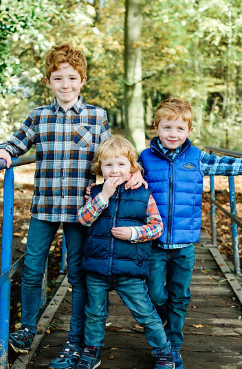 Three handsome boys on a bridge at East Carlton Park, Corby, Nortamptonshire