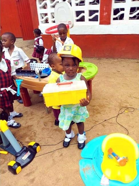 Girl holding toolbox.jpg