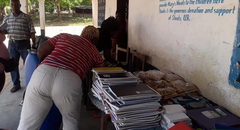 Volunteers giving out items.jpg