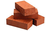 Stacked pile of red bricks
